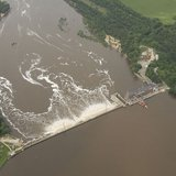 An aerial view of the Wisconsin River Dam at Prairie du Sac, Wis., from an UH-60 Blackhawk helicopter June 11, 2008. Severe conditions throughout the state prompted Governor Jim Doyle to declare a state of emergency, allowing Adjutant General, U.S. Air Guard Brigadier General Don Dunbar to activate National Guard troops to assist in the relief effort. By (U.S. Air Force photo by Master Sgt. Paul Gorman/Released) (www.defenseimagery.mil 080611-F-6967G-006) [Public domain], via Wikimedia Commons
