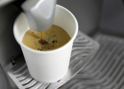 A coffee machine pours coffee into a paper cup in Kiev March 1, 2012. CREDIT: REUTERS/GLEB GARANICH