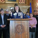 Renee Simpson, State Commander of the Wisconsin Veterans of Foreign Wars, shares her emotional story.  Simpson says her entire family has been exposed to asbestos. (PHOTO: Jackie Johnson, Wisconsin Radio Network)