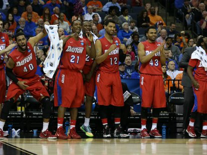 Dayton Flyers players celebrate on the bench as their entry into the Elite Eight gets finalized. Nelson Chenault-USA TODAY Sports / Reuters