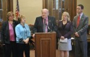 Legislators and supporters announce passage of adoption legislation.
