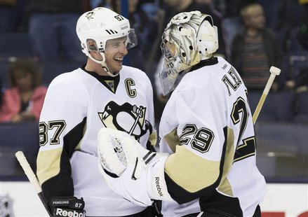 Mar 28, 2014; Columbus, OH, USA; Pittsburgh Penguins center Sidney Crosby (87) celebrates with goalie Marc-Andre Fleury (29) after defeating