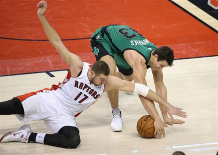 Mar 28, 2014; Toronto, Ontario, CAN; Boston Celtics forward Kris Humphries (43) wins a battle for the ball against Toronto Raptors center Jo