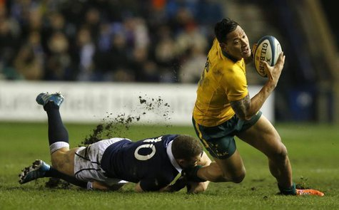 Australia's Israel Folau is tackled by Scotland's Duncan Weir during their rugby union international test match at Murrayfield Stadium in Ed