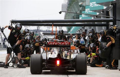Lotus Formula One driver Romain Grosjean of France pits during the third practice session of the Malaysian F1 Grand Prix at Sepang Internati