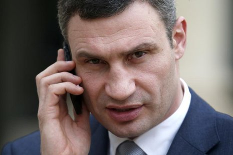Ukraine opposition leader Vitaly Klitschko, receives a phone call as he leaves the Elysee Palace in Paris, March 7, 2014. REUTERS/Charles Pl