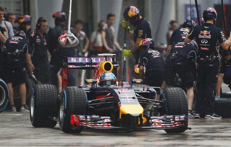 Red Bull Formula One driver Sebastian Vettel of Germany leaves his team garage during the qualifying session for the Malaysian F1 Grand Prix