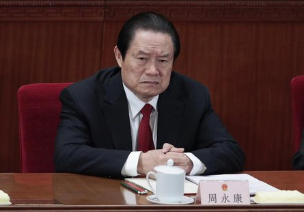 Former China's Politburo Standing Committee Member Zhou Yongkang attends the closing ceremony of the National People's Congress (NPC) at the