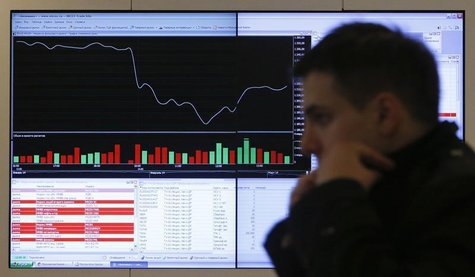 A man walks past an information screen on display inside the office of the Moscow Exchange in the capital Moscow March 14, 2014. REUTERS/Max