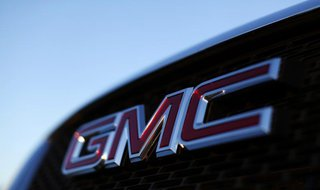 A General Motors logo is seen on a vehicle for sale at the GM dealership in Carlsbad, California January 4, 2012 file photo. REUTERS/Mike Bl