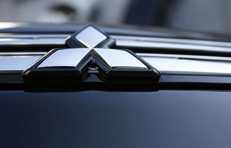 The logo of Mitsubishi Motors is seen on the front part of the company's car at the company showroom in Tokyo November 6, 2013. REUTERS/Isse