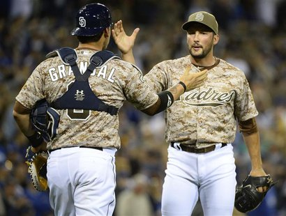 Mar 30, 2014; San Diego, CA, USA; San Diego Padres relief pitcher Huston Street (16) celebrates with catcher Yasmani Grandal (8) after winni