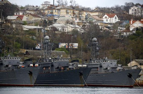 Russian Navy vessels are anchored at a navy base in the Ukrainian Black Sea port of Sevastopol in Crimea, March 28, 2014. REUTERS/Yannis Beh