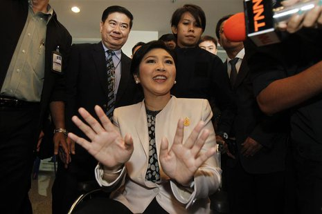 Thai Prime Minister Yingluck Shinawatra reacts as she leaves the National Anti-Corruption Commission office in Nonthaburi province, on the o