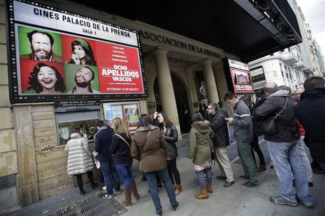 "People stand in line to buy tickets for the film ""8 Apellidos Vascos"" (8 Basque Surnames) at a cinema in central Madrid March 30, 2014. REUT"