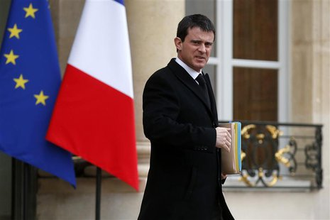 French Interior Minister Manuel Valls leaves after the weekly cabinet meeting at the Elysee Palace in Paris in this February 19, 2014 file p