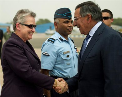U.S. Defense Secretary Leon Panetta (R) shakes hands with U.S. ambassador to India Nancy Powell upon his arrival in New Delhi in this file p
