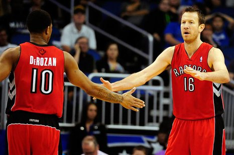 Mar 30, 2014; Orlando, FL, USA; Toronto Raptors guard DeMar DeRozan (10) celebrates with forward Steve Novak (16) against the Orlando Magic