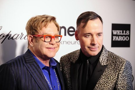 Musician Elton John (L) and his husband David Furnish pose at the 2014 Elton John AIDS Foundation Oscar Party in West Hollywood, California