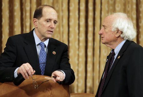 House Ways and Means Committee chair Rep. Dave Camp (R-MI) (L) confers with ranking member Rep. Sander Levin (D-MI) before their hearing on