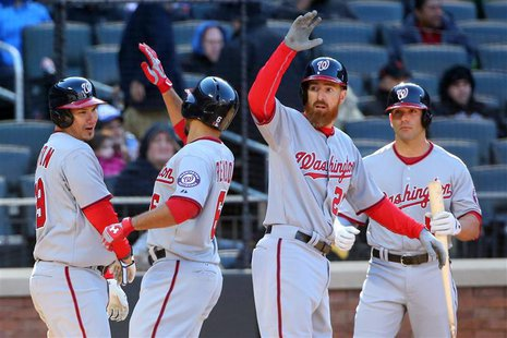 Mar 31, 2014; New York, NY, USA; Washington Nationals second baseman Anthony Rendon (6) celebrates his three run home run against the New Yo