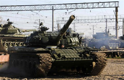 A T-72B Russian tank manouvers shortly after Russian tanks arrived at a train station in the Crimean settlement of Gvardeiskoye near the Cri