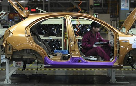 An employee works at a production line of an automobile factory in Hefei, Anhui province, January 9, 2014. REUTERS/Stringer