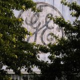 A faded, painted logo sits over the entrance to a General Electric Co. facility in Medford, Massachusetts July 17, 2009. REUTERS/Brian Snyde
