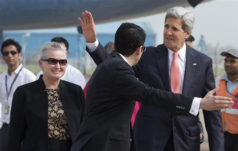 U.S. Secretary of State John Kerry waves in front of U.S. Ambassador to India Nancy Powell (L) upon his arrival in New Delhi in this June 23