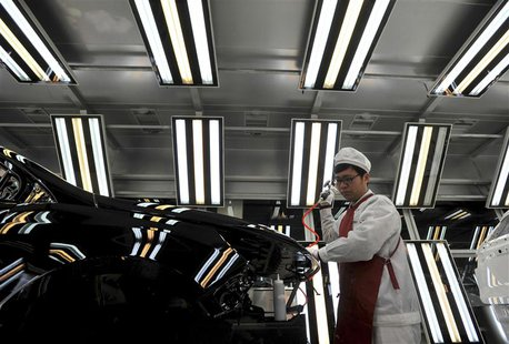 An employee works at a Chinese automobile factory in Hefei, Anhui province, in this file picture taken March 15, 2014. REUTERS/Stringer/File