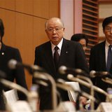 Nobel Prize-winning chemist and President of Japanese research institute RIKEN Ryoji Noyori (C) arrives with other RIKEN executives to a new