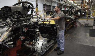 Chrysler assembly staff works on the chassis of a 2014 Dodge Ram pickup truck at the Warren Assembly Plant in Warren, Michigan December 11,