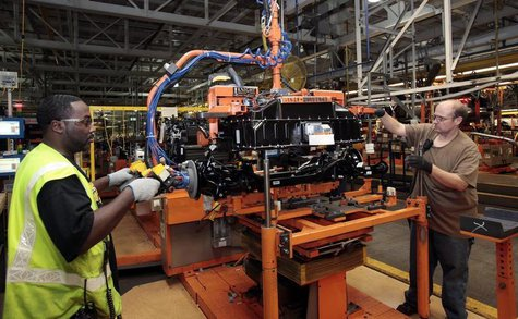 Ford Assembly workers install a battery onto the chassis of a Ford Focus Electric vehicle at the Michigan Assembly Plant in Wayne, Michigan,