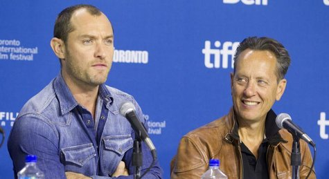 "Actors Jude Law and actor Richard E. Grant attend a news conference for the film ""Dom Hemingway"" at the 38th Toronto International Film Fest"