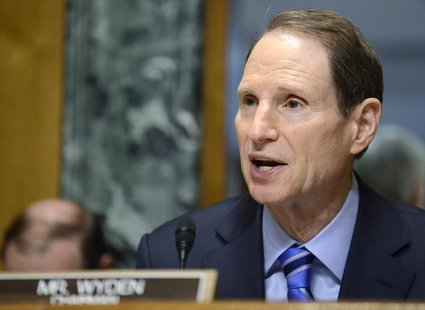 Senate Finance Committee Chairman Ron Wyden (D-OR), who is attending his first hearing as chairman after the retirement of Sen. Max Baucus (