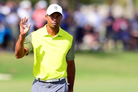 Mar 7, 2014; Miami, FL, USA; Tiger Woods acknowledges after a putt on the 18th green during the first round of the WGC - Cadillac Championsh