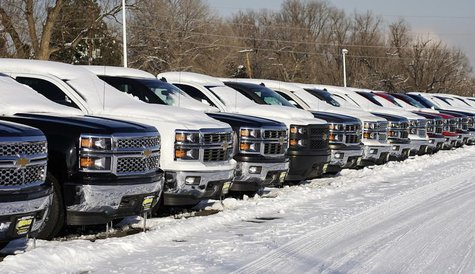 A line of Chevrolet trucks made by General Motors are seen for sale at a dealer in Wheat Ridge, Colorado February 6, 2014. REUTERS/Rick Wilk