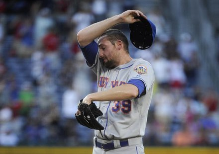 New York Mets pitcher Bobby Parnell regroups after allowing the Atlanta Braves to go ahead on an RBI single by Jason Heyward in the ninth in