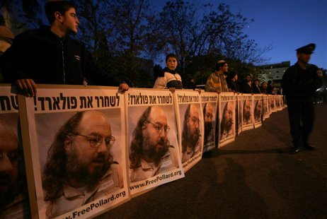 Israeli protesters hold posters calling for the release of Jonathan Pollard, who was imprisoned after being convicted for spying on the Unit