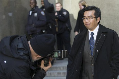 Photographer Sheng Li exits the Manhattan Criminal Court following his hearing in New York, April 1, 2014. REUTERS/Brendan McDermid