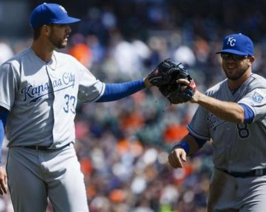 NOT SO FAST: Kansas City Royals starting pitcher James Shields (33) touches gloves with third baseman Mike Moustakas (8) after the first inning of an opening day baseball game against the Detroit Tigers at Comerica Park on Mar. 31, 2014. Detroit won, 4-3. Rick Osentoski-USA TODAY Sports