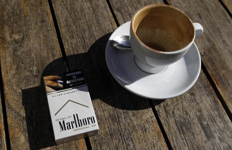A Marlboro cigarettes pack, a brand of Philip Morris Tobacco, lies next to an empty coffee cup at a cafe in central Sydney June 27, 2011. RE