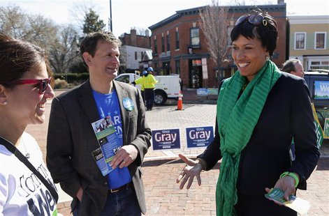 Councilmember Muriel Bowser (R) talks to people in Precinct 89 Eastern Market during the District of Columbia Democratic mayoral primary ele