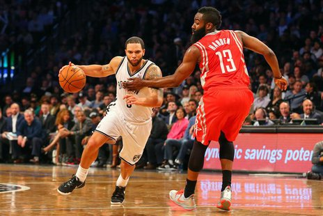 Apr 1, 2014; Brooklyn, NY, USA; Brooklyn Nets guard Deron Williams (8) dribbles the ball past Houston Rockets guard James Harden (13) during