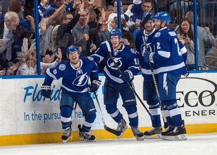 Apr 1, 2014; Tampa, FL, USA; Tampa Bay Lightning defenseman Eric Brewer (2) celebrates scoring a goal with right wing Teddy Purcell (16), ri