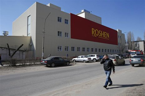 A man walks past a Roshen Confectionery Corporation plant in Lipetsk March 28, 2014. REUTERS/Artur Bainozarov