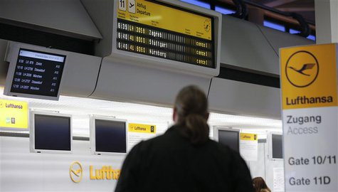 A man looks at cancelled flights by German air carrier Lufthansa on a flight schedule board at Berlin Tegel airport April 2, 2014. REUTERS/F
