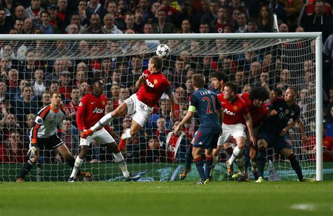 Manchester United's Nemanja Vidic (C) scores a goal against Bayern Munich during their Champions League quarter-final first leg soccer match