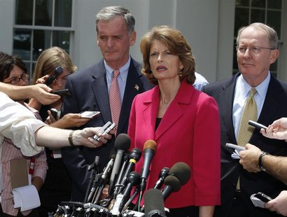 U.S. Sen. Lamar Alexander (R), U.S. Sen. Lisa Murkowski (2nd R), and U.S. Sen. Judd Gregg (3rd R) talk after meeting with U.S. President Bar
