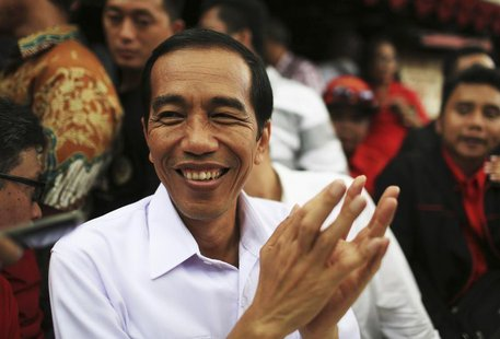 Jakarta governor and presidential candidate Joko Widodo, of the Indonesian Democratic Party of Struggle (PDI-P), reacts during a party campa
